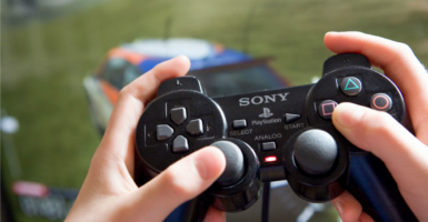 More than half of poor families with children have a video game system, such as an Xbox or PlayStation. (Photo: Caro / Dobiey/Newscom)