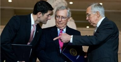 Senate Majority Leader Mitch McConnell,  center, quarterbacked passage of a short-term continuing resolution  three days before the federal government's spending authority expires Oct. 1.  House Speaker Paul Ryan, left, and Senate Minority Leader Harry Reid, right,  confer here with McConnell. (Photo: Tom Williams/CQ Roll Call/Newscom)