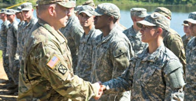 Army Chief of Staff Gen. Mark A. Milley congratulates Capt. Kristen Griest, one of the first two female graduates of the elite Ranger School, on Aug. 21, 2015. (Photo: Polaris/Newscom)