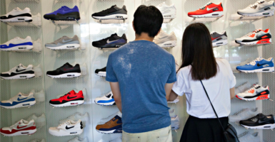 A 12.5 percent drop in imports is the biggest sign of a slowdown in China's domestic growth. Here, shoppers check out athletic shoes in the Mong Kok district of Hong Kong on Aug. 22, 2016. (Photo: Alex Hofford/EPA /Newscom)