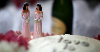 A Pew poll finds that 49 percent agree that wedding-related businesses should be required to provide services to same-sex couples, regardless of religious objections, while 48 percent disagree. (Photo: Lucy Nicholson /Reuters/Newscom)