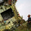 A Malaysian air crash investigator inspects the crash site of Malaysia Airlines Flight 17, near the village of Hrabove in the Donetsk region, Ukraine, July 22, 2014. (Photo: Maxim Zmeyev /Reuters/Newscom)