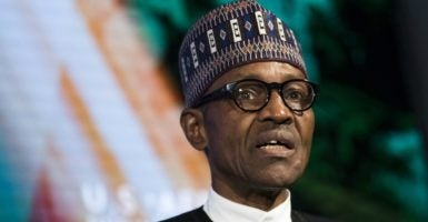 Job creation has been impeded in Nigeria by bureaucratic rigidity and corruption in the economy, causing increased frustration among underemployed youth.. Pictured is President of Nigeria Muhammadu Buhari. (Photo: Drew Angerer/ZUMA Press/Newscom)