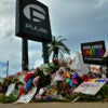 Six days later, mourners pay tribute to the victims of the June 12 terrorist attack at Pulse nightclub in Orlando, Florida.  (Photo: Julian Leek/newzulu /Newscom)