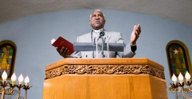 Two U.S. congressmen have introduced a bill that would expand the ability of pastors to comment on political matters. (Photo: Hill Street Studios Blend Images/Newscom)