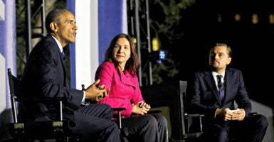 President Barack Obama, on stage with actor Leonardo DiCaprio and climate scientist Katharine Hayhoe,  discusses climate change Monday night on the South Lawn of the White House. (Photo: Aude Guerrucci /Pool/CNP/Newscom)
