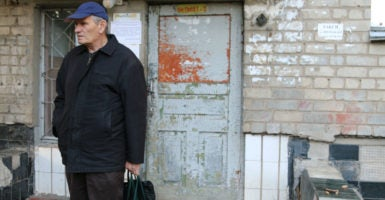 Valeriy Ivanenko outside the apartment in Bahmut, Ukraine, where he and his wife, Vira, sought refuge after fleeing their home. (Photo: Nolan Peterson /The Daily Signal)