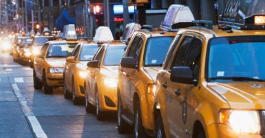 Some cities require the purchase of an existing license for taxicabs, sometimes called a medallion, which has cost as much as over $1 million. (Photo: Ditto Image Source /Newscom)