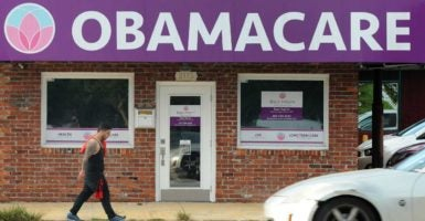 An Orlando man walks by a local Affordable Care Act enrollment center on May 19. (Photo: Paul Hennessy/Polaris/Newscom)