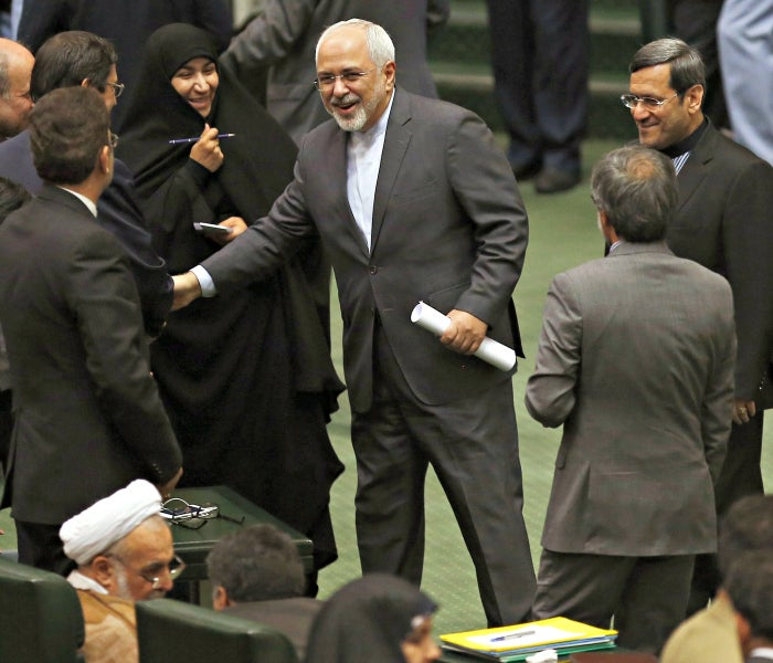 Iranian Foreign Minister Mohammad Javad Zarid greets lawmakers as he arrives for a parliament session in Tehran. (Photo: EPA/Newscom)