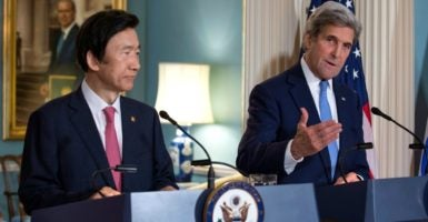 Secretary of State John Kerry, on the right, with South Korea's Minister of Foreign Affairs Yun Byung-se, responds to a question from the news media. (Photo: Shawn Thew/EPA/Newscom)
