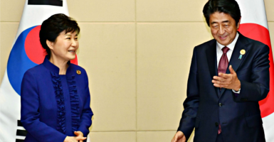Washington should encourage growing security cooperation between Japan and South Korea. Here, Japanese Prime Minister Shinzo Abe, right, meets with South Korean President Park Geun Hye in Vientiane, Laos, on Sept. 7 on the sidelines of regional summit meetings. (Photo: Kyodo/Newscom)