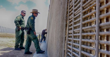 Border Patrol agents patrol the U.S.-Mexico border fence at Friendship Park in San Ysidro. (Photo: Sandy Huffaker/Zuma Press/Newscom)