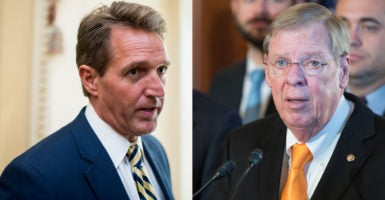 Sen. Jeff Flake, R-Ariz., (left), and Sen. Johnny Isakson, R-Ga., (right) spoke about what to do about the Supreme Court after the presidential election. (Photos: Flake—Bill Clark/CQ Roll Call/Newscom; Isakson—Zuma Press/Newscom)
