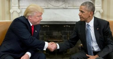 President-elect Donald Trump and President Barack Obama shake hands Thursday after meeting more than an hour talking about the transition. (Photo: Michael Reynolds /EPA/Newsom)
