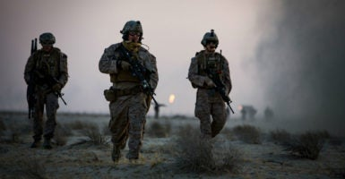 U.S. Marines run toward a simulated casualty while conducting a Tactical Recovery of Aircraft and Personnel exercise, Oct. 8, 2016. (Photo: Cpl. Trever Statz/UPI/Newscom)