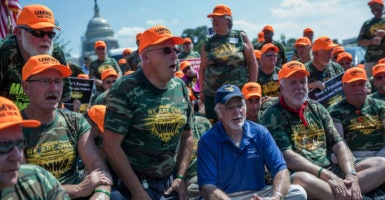 United Mine Workers of America International President Cecil Roberts and members of UMWA sit in civil disobedience prior to being arrested in a parking lot on the West Front of the U.S. Capitol in Washington, D.C., Sept. 8, 2016. The rally was held to urge Congress to pass legislation to preserve benefits for retired coal miners and widows. (Photo: Shawn Thew/EPA/Newscom)