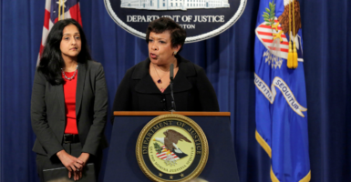 Attorney General Loretta E. Lynch gives remarks, with Acting Assistant Attorney General Vanita Gupta, head of the Civil Rights Division, behind her. (Photo: Joshua Roberts/Reuters /Newscom)