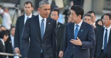 President Barack Obama and Japan's Prime Minister Shinzo Abe leave after laying wreats at the Hiroshima Peace Memorial Park in Hiroshima, Japan, in May. (Photo: AFLO/Newscom)
