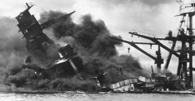 The battleship USS Arizona sinks after being hit by a Japanese attack on Pearl Harbor. (Photo: Handout/Reuters/Newscom)