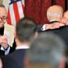 Sen. Chuck Schumer, left, here looking on Dec. 8 as Vice President Joe Biden embraces retiring Senate Minority Leader Harry Reid, said Democrats would not force a shutdown by holding out for a year of health benefits for retired coal miners. (Photo: Jonathan Ernst/Reuters/Newsom)