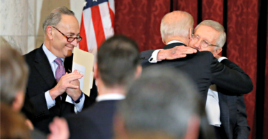 Sen. Chuck Schumer, left, here looking on Dec. 8 as Vice President Joe Biden embraces retiring Senate Minority Leader Harry Reid, said Democrats would not be responsible for a government shutdown for lack of funding.  (Photo: Jonathan Ernst/Reuters/Newsom)