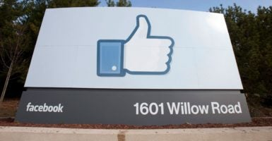 Facebook has announced it will crack down on fake news through a variety of ways, including letting users report what they deem to be fake news. (Photo: Peter DaSilva/EPA /Newscom)
