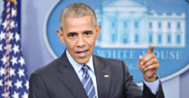 """""""I'm finding it a little curious that everyone is acting surprised that this looked like it was disadvantaging Hillary Clinton,"""" President Obama says in his final White House press conference of 2016. (Photo: Olivier Douliery /CNP/Newscom)"""