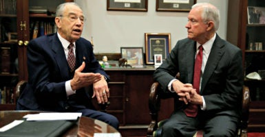 Sen. Jeff Sessions, right, meets Nov. 29 with Sen. Charles Grassley, chairman of the Judiciary Committee, to talk about Sessions' impending nomination as U.S. attorney general. (Photo: Gary Cameron/Reuters/Newscom)