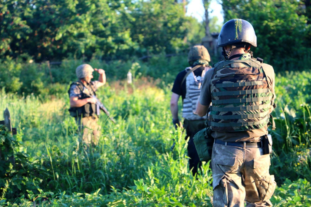 Ukrainian soldiers on patrol in the eastern Ukrainian town of Pisky. (Photo: Nolan Peterson/The Daily Signal)
