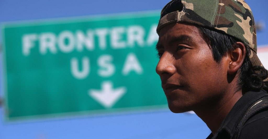 An immigrant walks near the U.S.-Mexico border. (Photo: John Moore/Getty Images)