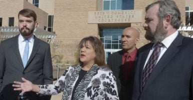 Arlene Harjo, center, successfully fought the city of Albuquerque's April 2016 seizure of her car in court. Her car was ultimately returned, but Harjo, along with her lawyers Robert Johnson, left, and Robert Frommer, right, of the Institute for Justice, are continuing their challenge of Albuquerque's vehicle forfeiture program. (Photo: Greg Sorber /Zuma Press/Newscom)