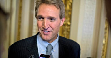 "Sen. Jeff Flake, R-Ariz., here with reporters in the Capitol in November 2013, has issued a second ""Wastebook"" detailing pork projects funded by tax dollars.  (Photo: Tom Williams/CQ Roll Call/Newscom)"