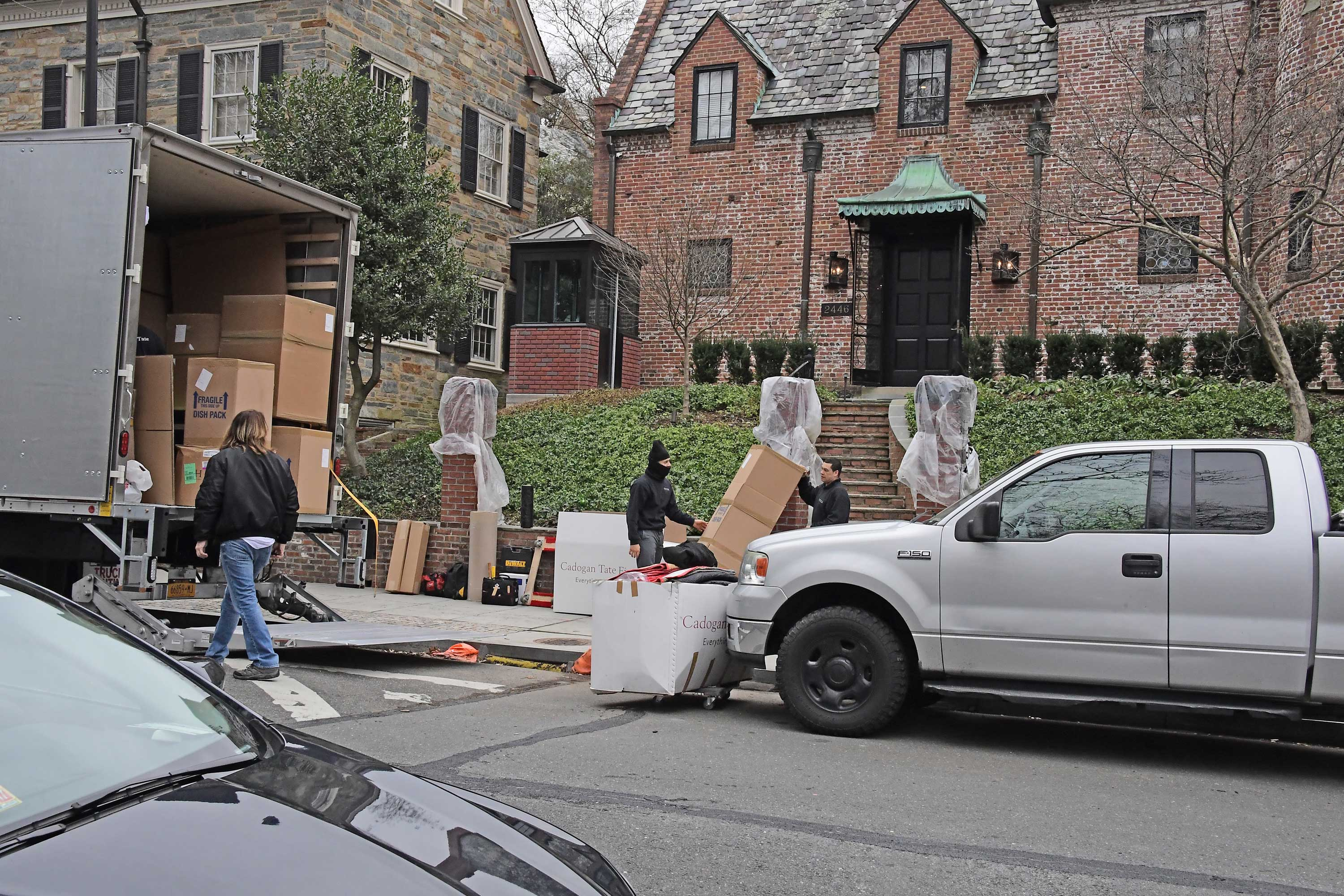 Movers take boxes from a truck to 2446 Belmont Road, NW in Washington, D.C. the home that President Barack Obama and his family will be living after he departs the White House Friday. (Photo: Ron Sachs/CNP/Polaris/Newscom)
