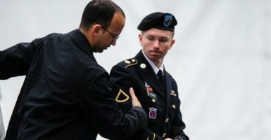 In 2013, Army Pfc. Bradley Manning, right, was sentenced to 35 years in prison for leaking over 700,000 confidential military documents to WikiLeaks.(Photo: Pete Marovich/EPA /Newscom)