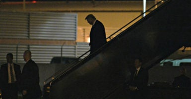 Donald Trump deplanes  the evening of Jan. 18 at Ronald Reagan Washington National Airport for dinner events in Washington. (Photo: Olivier Douliery/ZumaPress/Newscom)