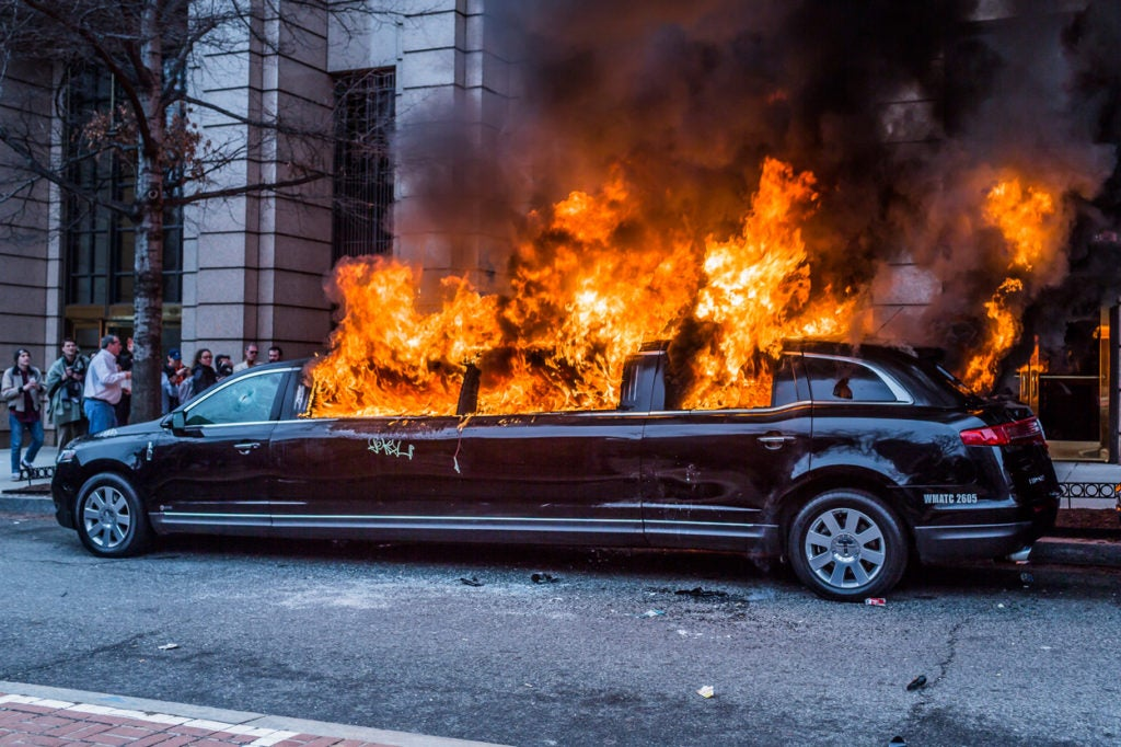 A limo burns in the streets of Washington, D.C. (Photo: Michael Nigro/Sipa USA/Newscom)