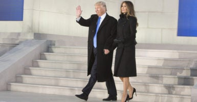 President Donald Trump and first lady Melania Trump greet the crowd at the Make America Great Again Welcome Celebration, held at the Lincoln Memorial. (Photo: Chris Kleponis /ZUMA Press/Newscom)