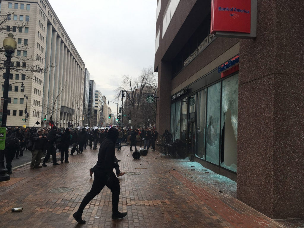 The window of a Bank of America branch in Washington, D.C. is smashed as violence erupts during the march against Trump's inauguration. (Photo: Josh Stafford/newzulu/Newscom)
