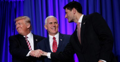 "House Speaker Paul Ryan, here at Republican lawmakers' retreat in Philadelphia with President Donald Trump and Vice President Mike Pence, says the party has a ""moral obligation"" to replace Obamacare with a health care system that works. (Photo: Jonathan Ernst /Reuters/Newscom)"