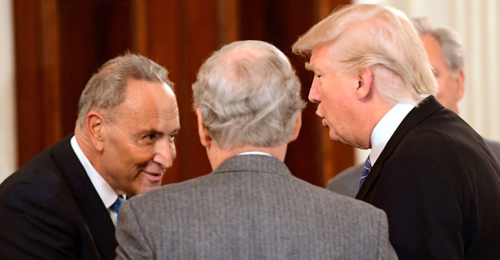 President Donald Trump welcomes Senate Minority Leader Chuck Schumer, D-N.Y., and Senate Majority Leader Mitch McConnell, R-Ky., to the White House. (Photo: Ron Sachs/ZUMA Press/Newscom)