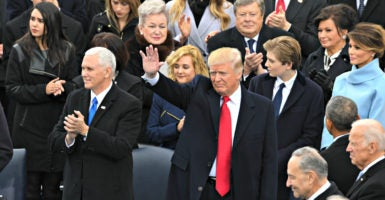 """Senate Minority Leader Chuck Schumer,  pictured at bottom right during President Donald Trump's inauguration Jan. 20, says Democrats will support only a """"really good"""" Supreme Court nominee. (Photo: Richard Ellis/ZumaPress/Newscom)"""