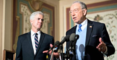 Judge Neil Gorsuch, President Trump's nominee to the Supreme Court, greets reporters Wednesday with Senate Judiciary Chairman Charles Grassley, R-Iowa.(Photo: Bill Clark/CQ Roll Call/Newscom)