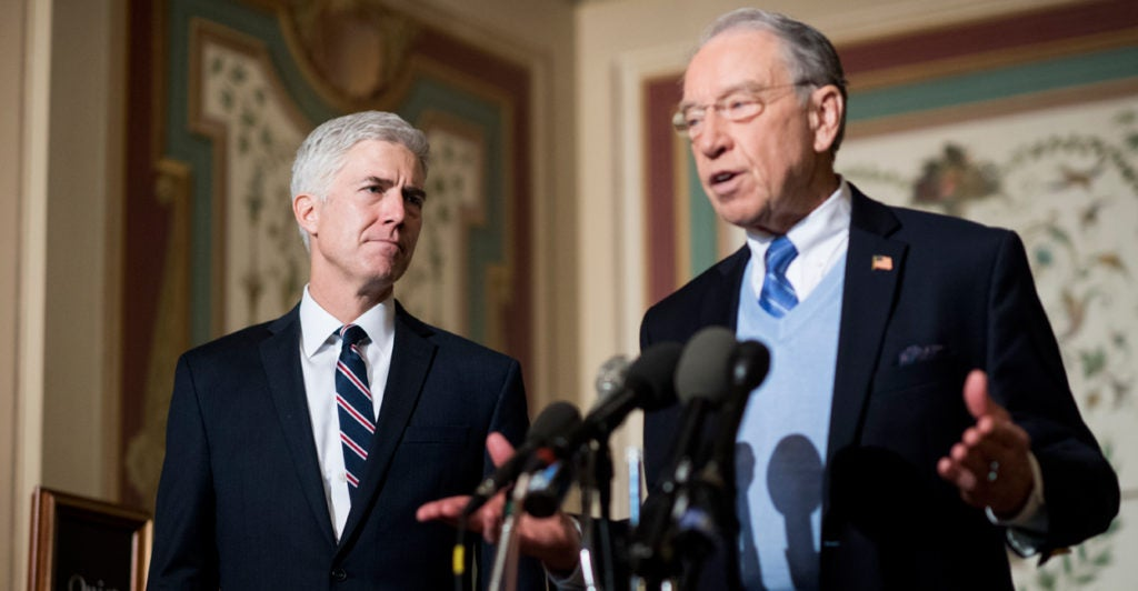 Judge Neil Gorsuch looks on as Senate Judiciary Chairman Chuck Grassley, R-Iowa, speaks to reporters in the U.S. Capitol. (Photo: Bill Clark/CQ Roll Call/Newscom)