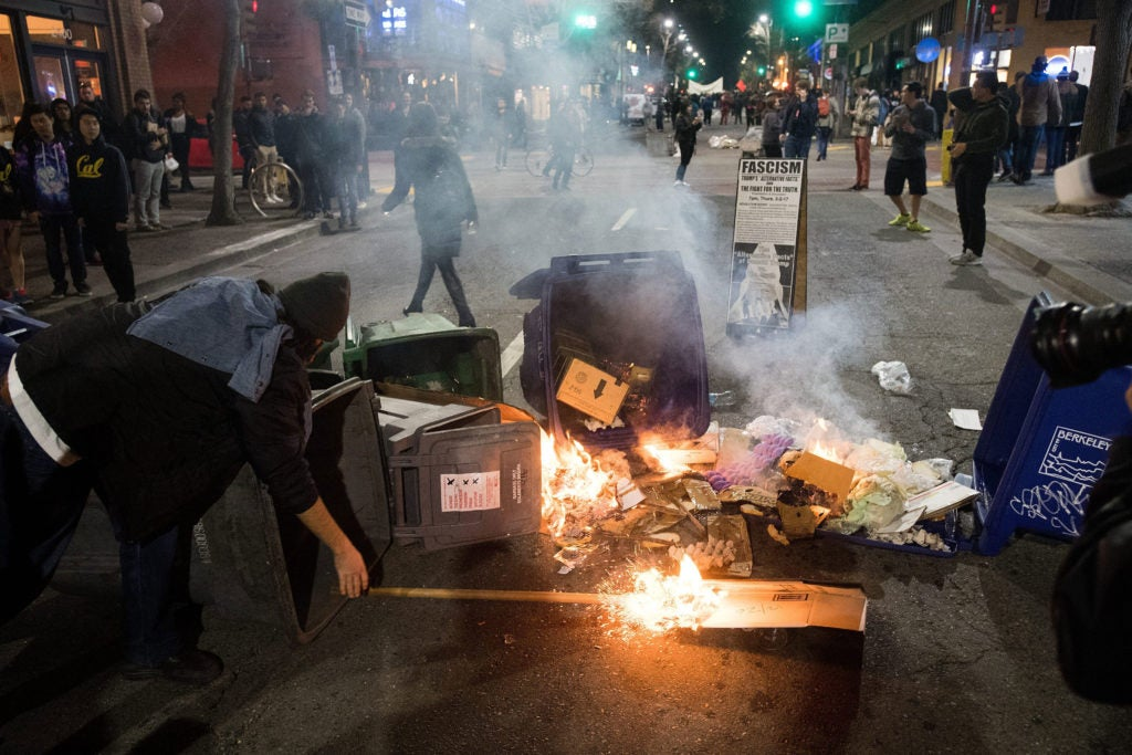 A demonstrator protesting Yiannopoulos sets a fire in Berkeley, California. (Photo: Noah Berger/EPA/Newscom)
