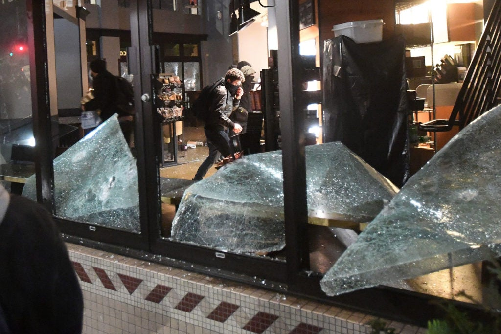 Rioters loot and vandalize a Starbucks during a protest against Yiannopoulos in Berkeley, California. (Photo: Noah Berger/EPA/Newscom)