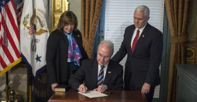 Tom Price signs the official forms after being sworn in by Vice President Mike Pence as the health and human services secretary in the vice president's Ceremonial Office in the EEOB next to the White House. (Photo: Pat Benic/UPI/Newscom)