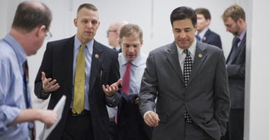 Republican Reps. Scott Perry of Pennsylvania, left, Jim Jordan of Ohio, middle, and Raul Labrador of Idaho, right, are all members of the House Freedom Caucus. The group voted to back a plan to bring a 2015 bill repealing major parts of Obamacare before members again for a vote. (Photo: Tom Williams/CQ Roll Call/Newscom)