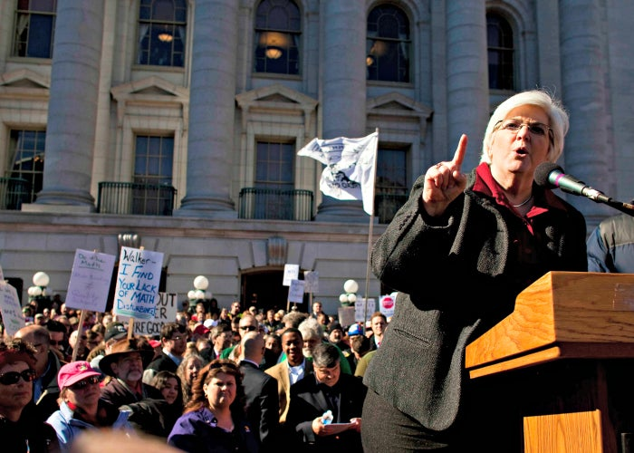 Mary Bell, president of the Wisconsin Education Association Council, speaks to protesters crowding the State Capitol grounds in Madison as Wisconsin lawmakers discuss Gov. Scott Walker's budget bill on Feb. 18, 2011. (Photo: Darren Hauck/Reuters/Newscom)