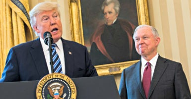President Donald Trump entrusted Attorney General Jeff Sessions, right during his swearing-in Feb. 9 in the Oval Office, to prepare a directive rescinding President Barack Obama's transgender mandate for public schools. (Photo: Jim LoScalzo/Consolidated/DPA/Newscom)